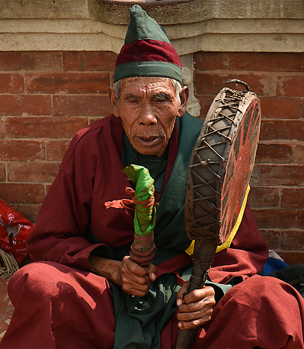 Monk with Tambourine