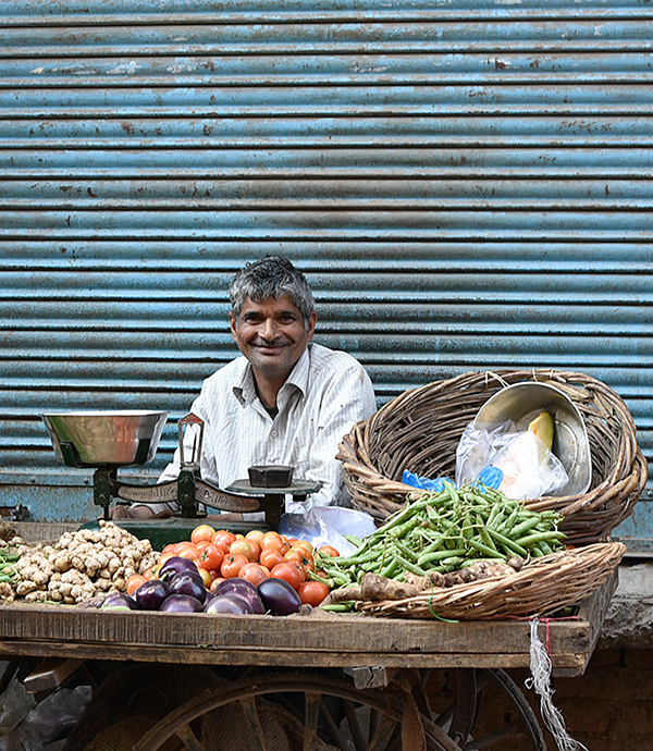 Man Selling Vegetables in Marketplace